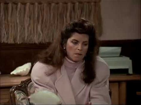 Kirstie Alley in cheers hiding a cigaret in her mouth
